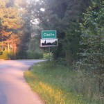 Cieślin - Znak drogowy D-42 (Obszar zabudowany) na wjeździe od strony Kwaśniowa